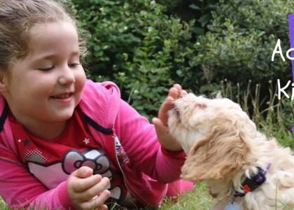 Girl and puppy playing together